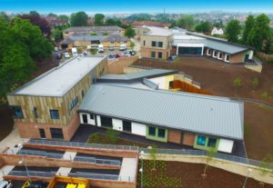 Multi-discipline project with flat roofs, cladding and pitched roofs