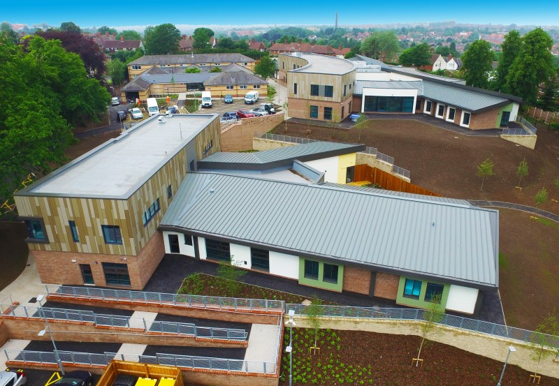 Multi-discipline project with pitched, flat, hard metal and green roof elements