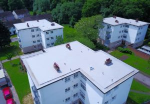 Blocks of flats with liquid and felt roofing