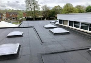 Flat Roof on school with rooflights and single ply membrane