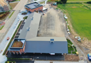multi-discipline project on a school with pitched, flat, hard metal and green roof elements